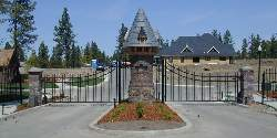 Ornamental Double Drive Gates With A Castle Theme