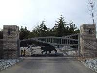 Large brick columns are used to accent this gate